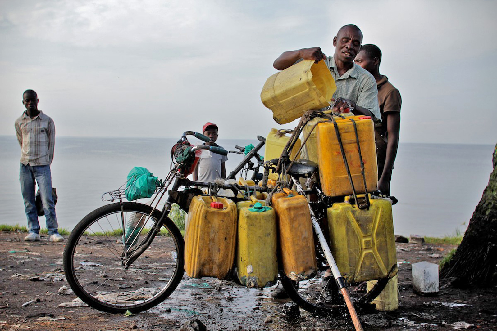 A man loads water collected from Lake Kivu onto his bicycle for sale in the rebel-held city of Goma