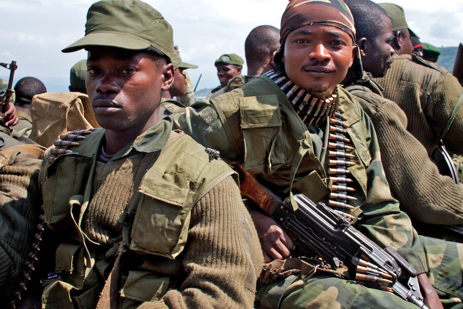 Government army (FARDC) troops in Minova, Democratic Republic of Congo, move to positions in the hills around the town