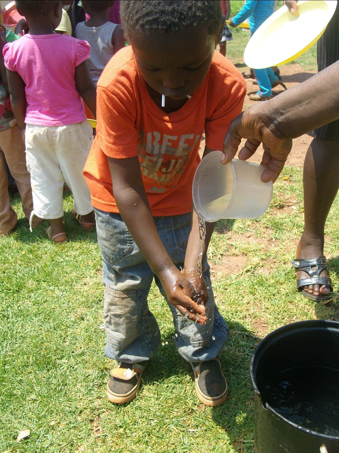 A child washes his hands at one of of Swaziland's 1,100 Neighbourhood Care Points