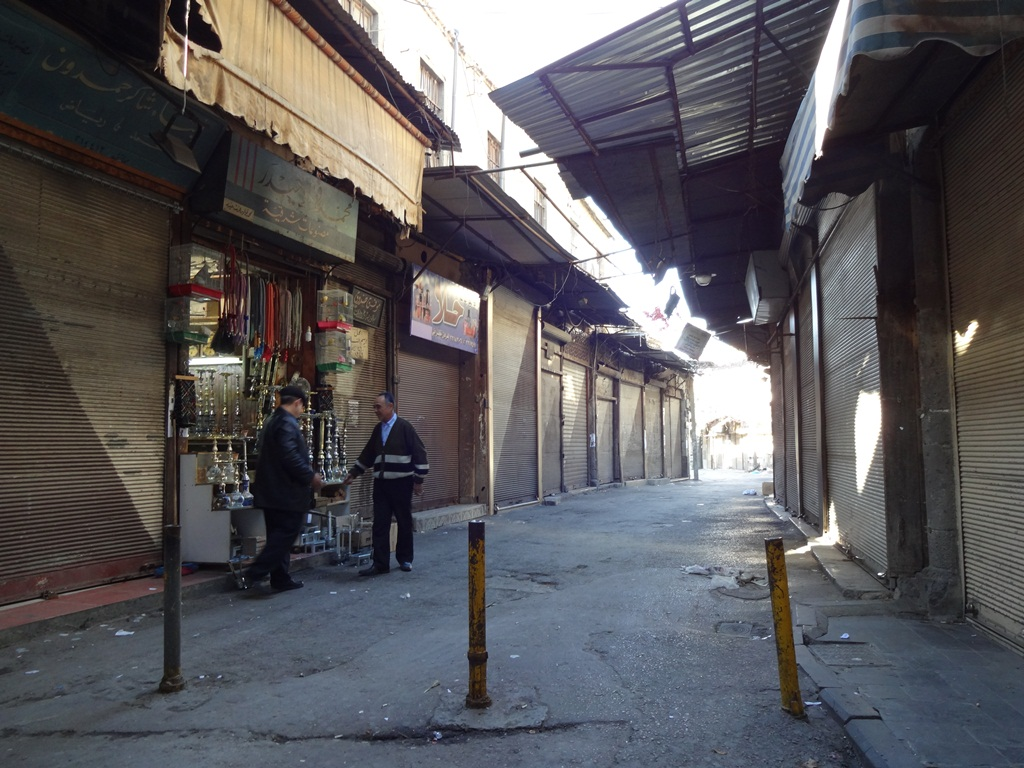 A lone shopkeeper stays open in the Old Souq of Damascus, the Syrian capital. Most shopkeepers close on Fridays, but as conflict, unemployment and rising prices have driven away customers, this man is desperate for a sale