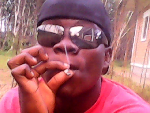 A cannabis smoker in Monrovia, December 2012