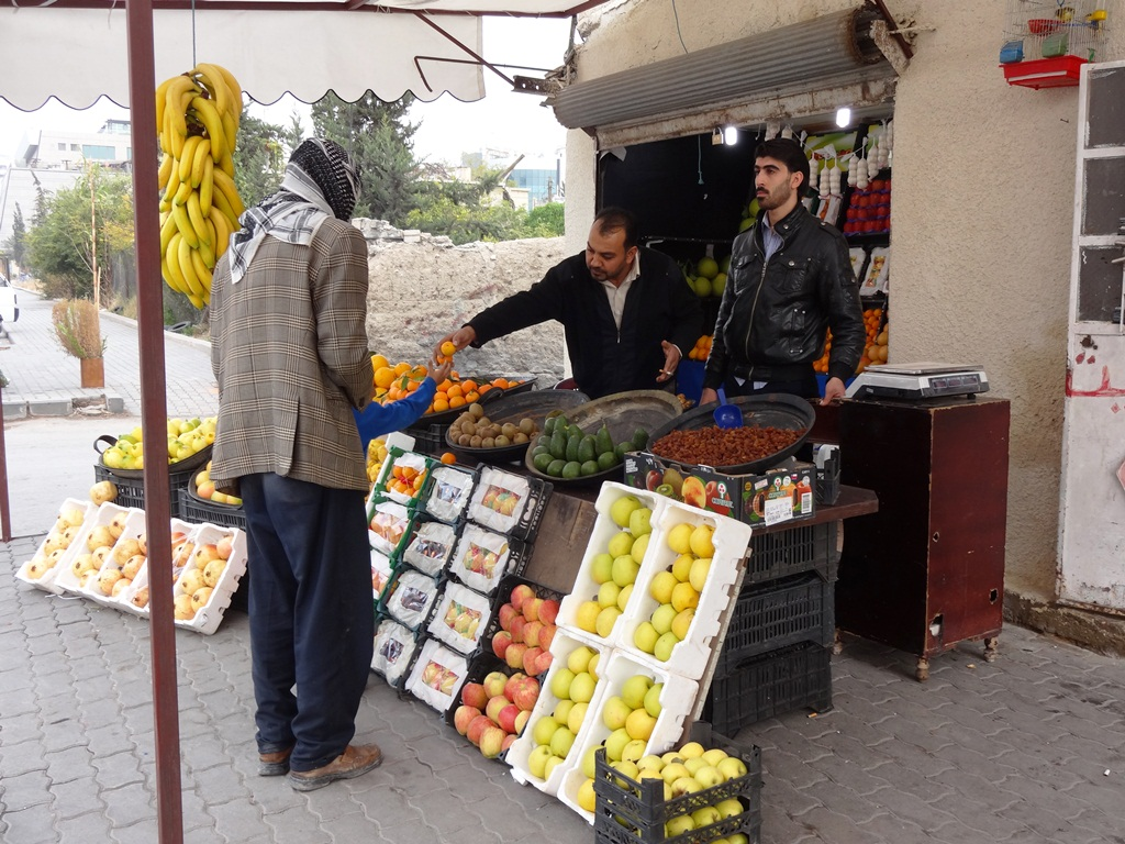 A fruit and vegetable stand in the Syrian capital Damascus. While food is still available in the markets, it has increased in price