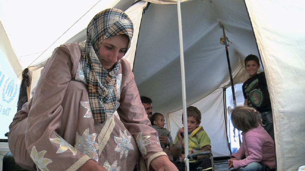 A Syrian refugee family shares a tent in Jordan