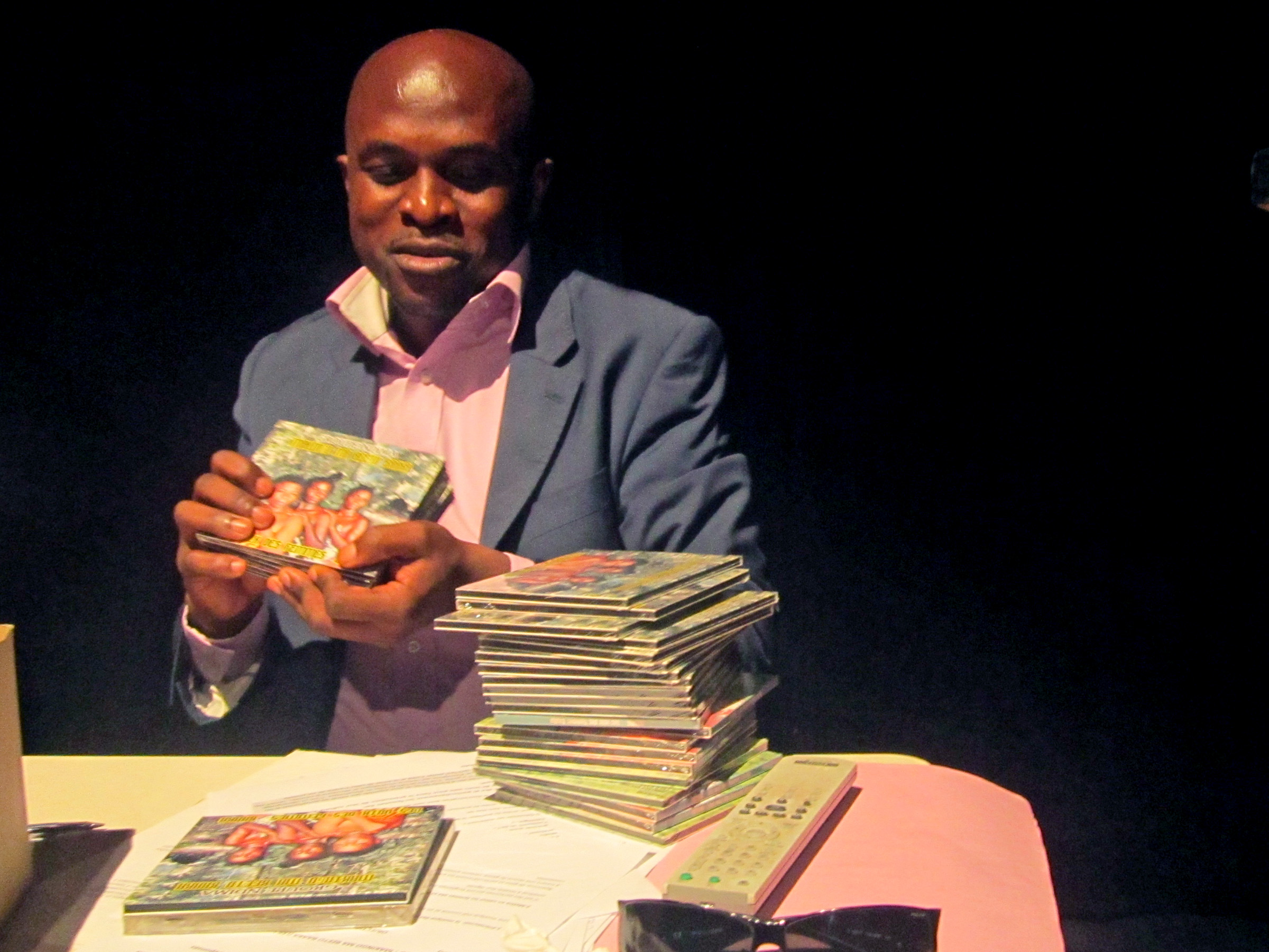 Congolese ethnologist displays a recently-released CD he produced of songs sung by the indigenous Baka community