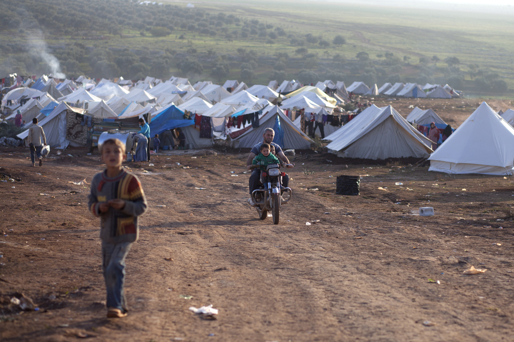Displaced Syrians at Atma Camp on the Syrian side just over the border with Turkey on December 2, 2012. Atma has become the temporary home to more than 11,000 people who have fled the violence as war flared in Syria