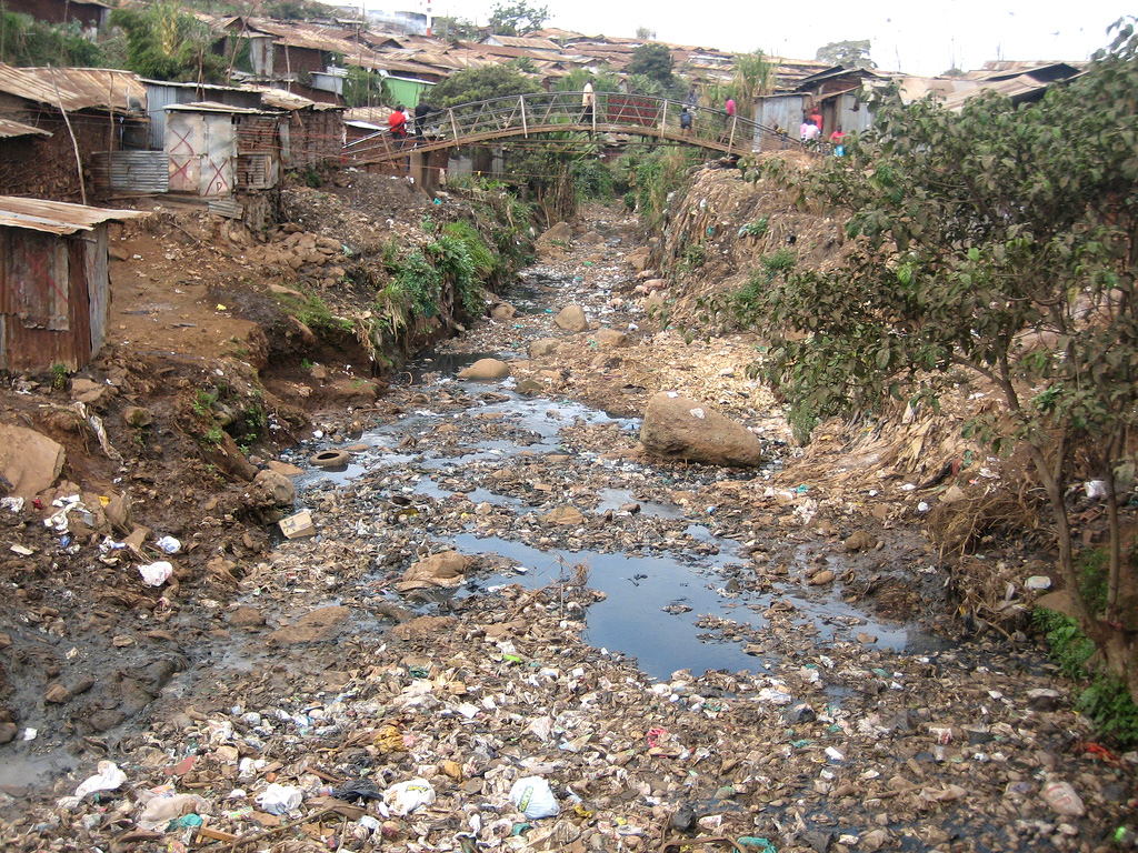 A stream in Kibera slum, used as a dump site for trash and human waste