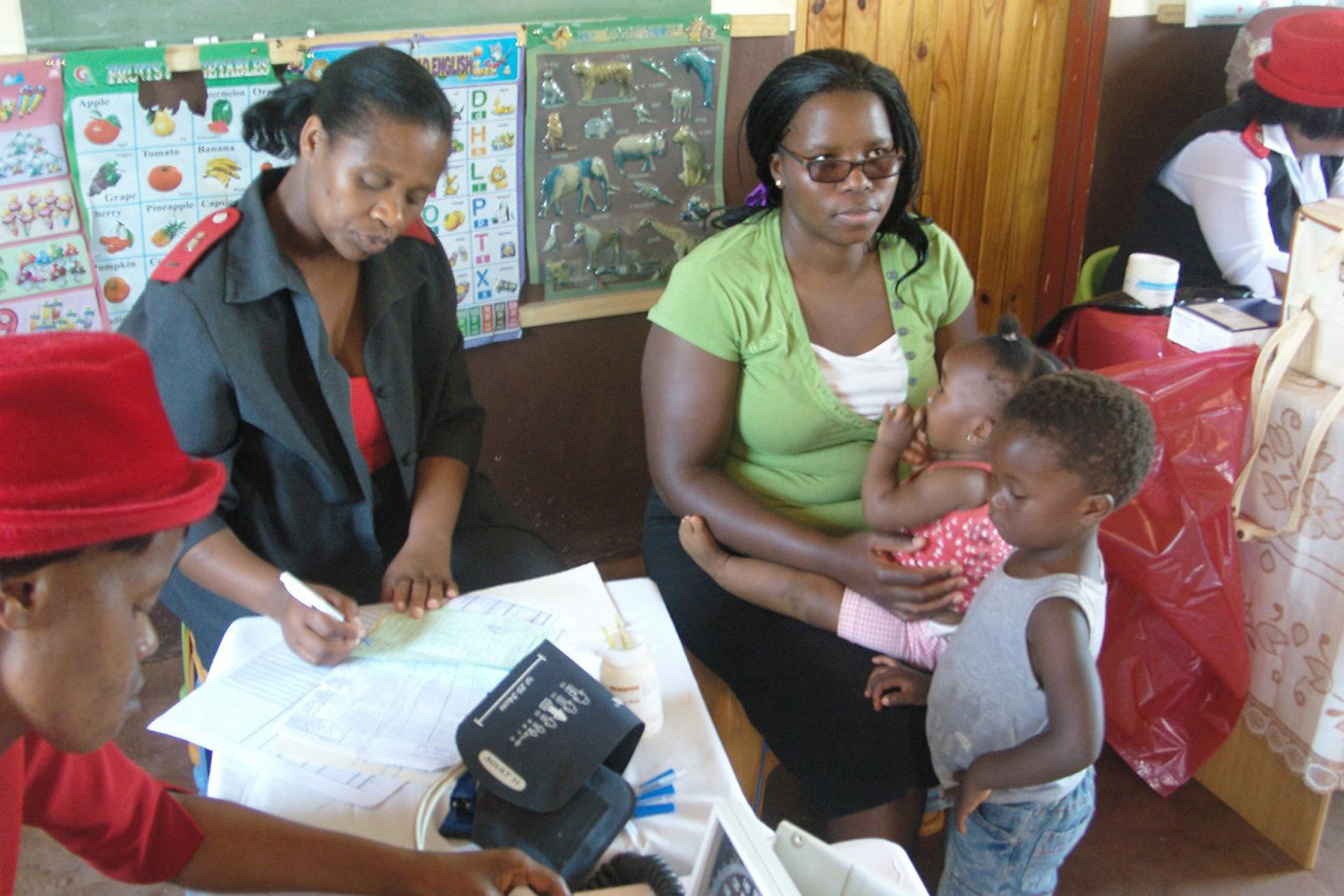 A single mother and her two children receive a check up at a public health facility in Swaziland