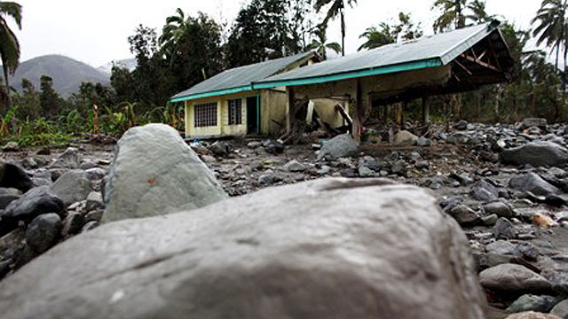 Only part of school remains in the town of Andap, Compostela Valley, Davao, southern Philippines. The region's education infrastructure was badly impacted by Typhoon Bopha in December 2012