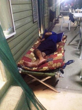 A resident of the Manus Island offshore processing centre sleeping outside. Many of the residents are from Sri Lanka