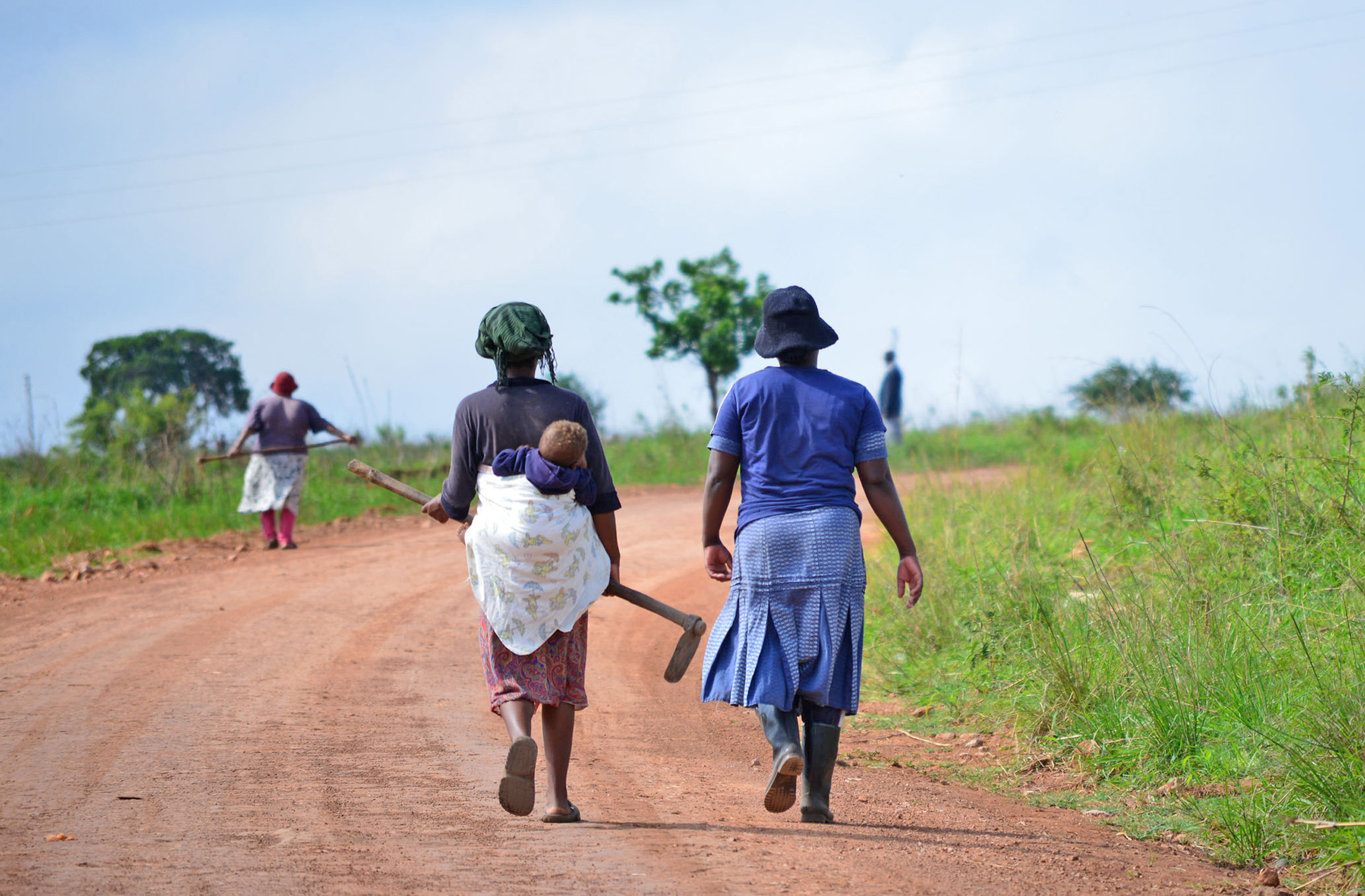 Women walk down a road in Swaziland's eastern Lubombo District. Much of the agricultural work in Swaziland is done by women