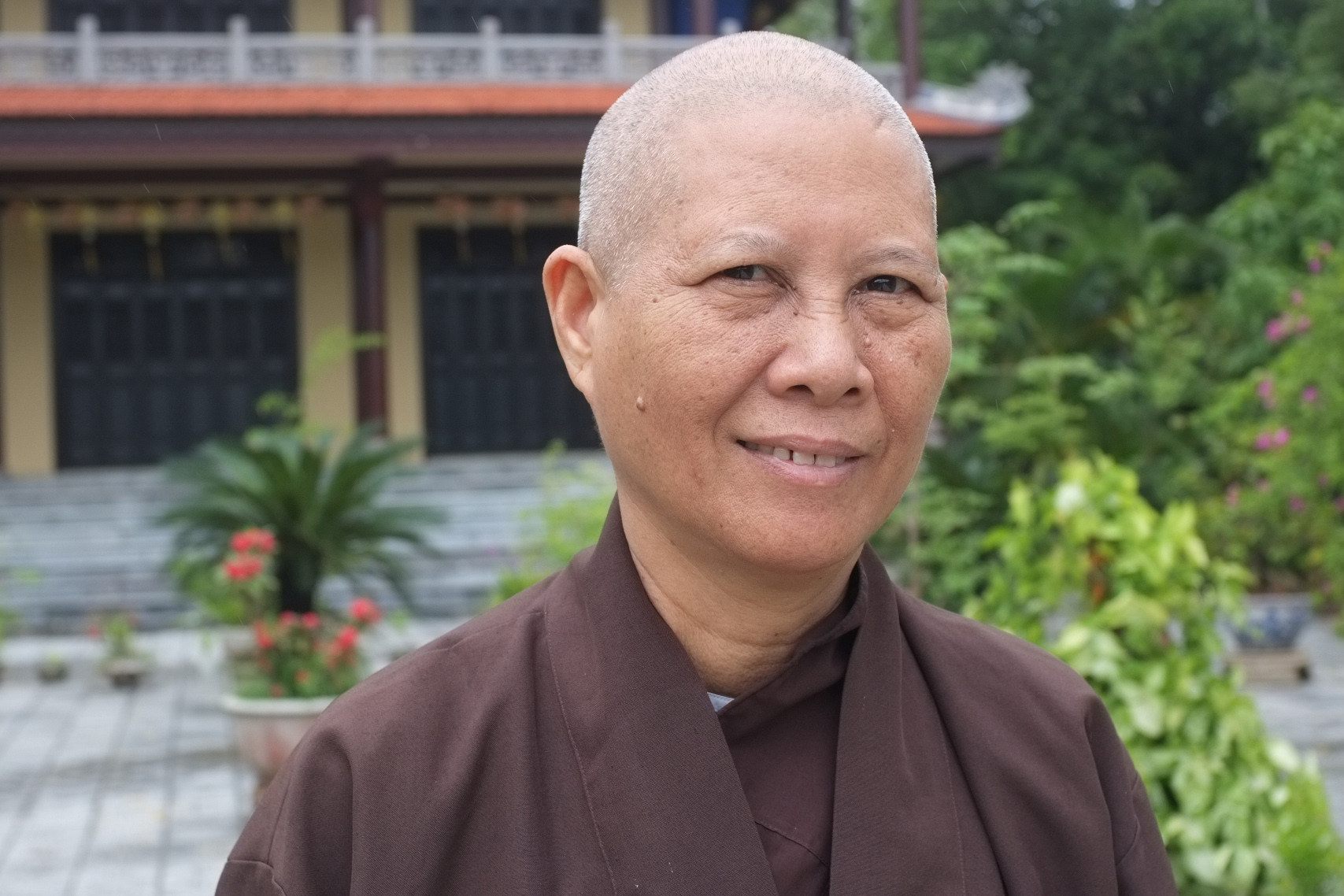 Buddhist nun, Sister True Compassion, outside Tay Linh temple in Hue, Vietnam. Buddhist temples have played a significant, though understudied, role in disaster response