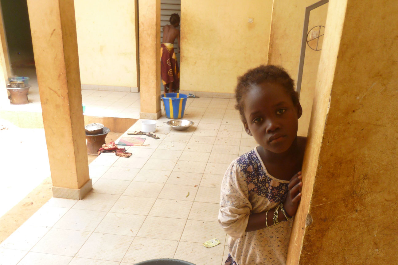 A child whose family was displaced from Timbuktu and who has been living in an abandoned house just outside of Sevare in Mopti region since mid-2012