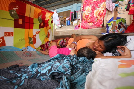 A young mother nurses her child at a shelter in Mindanao, which was badly affected by Typhoon Bopha in December 2012. More than 6.2 million people were affected