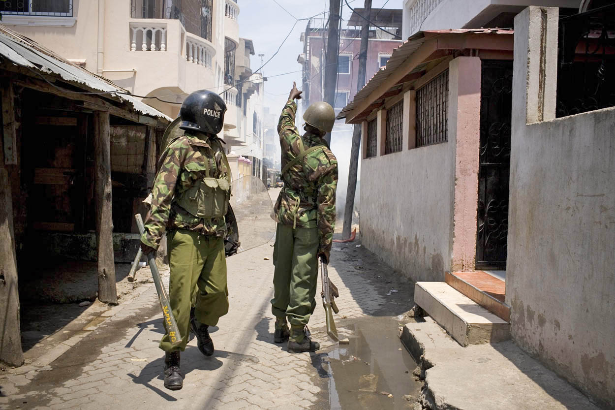 Kenyan police patrol the streets following days of unrest in Mombasa, Kenya (Aug 2012)