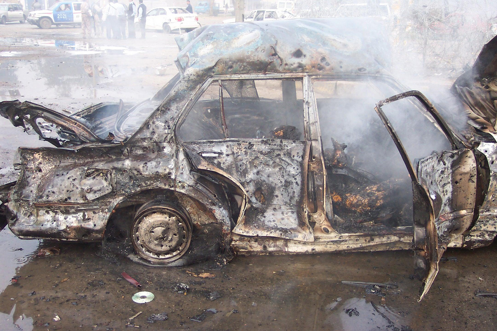 Charred body parts are among the remains of a massive suicide car bombing in the Iraqi capital Baghdad in December 2007