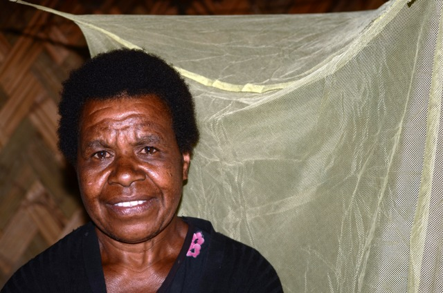 Susan Kake, 45, inside her hut in Masumave, a village of 2,000 largely subsistence farmers in PNG's remote Eastern Highlands Province, rarely sleeps under the bednet behind her. Malaria remains endemic in the country