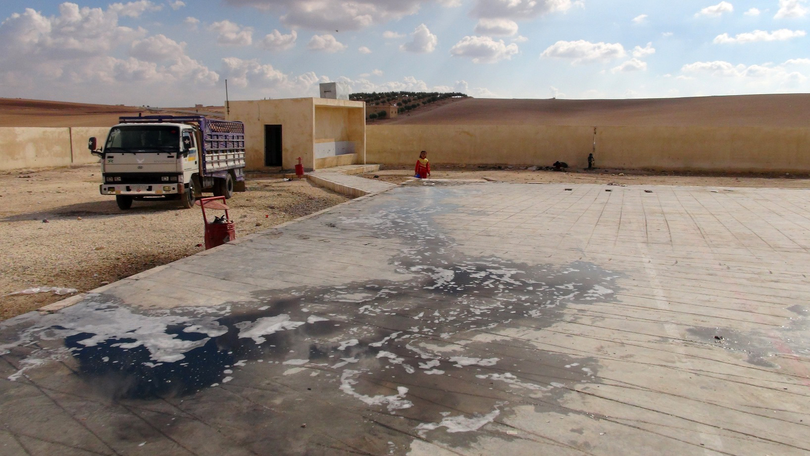 A sanitation facility in a shelter for IDPs in north-eastern Syria, with sewage water leaking into the ground. Sewerage systems have all but broken down during the conflict