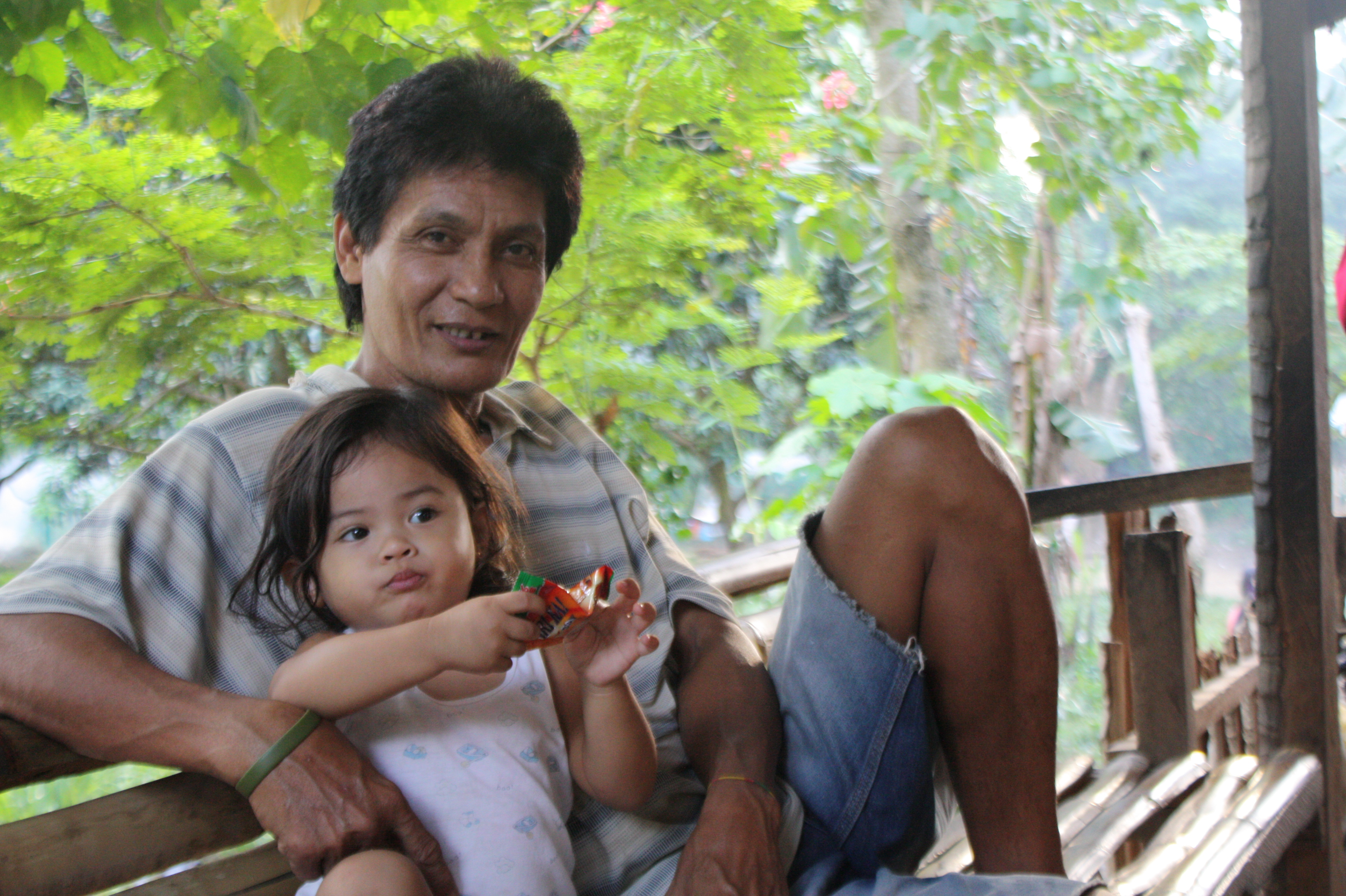 A family from Davao that is staying put post-floods -- illegally