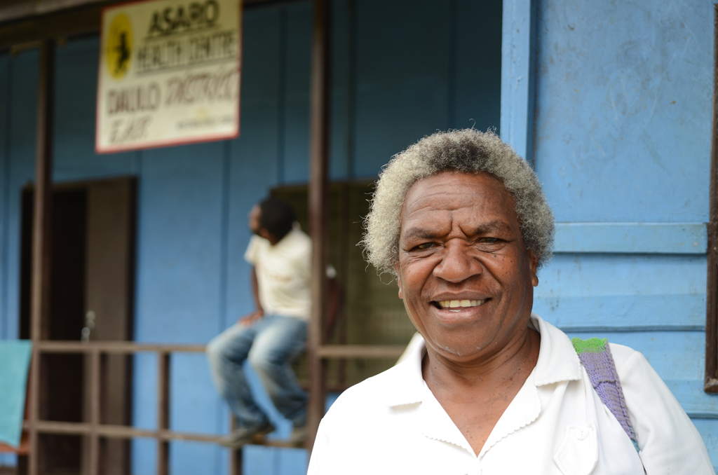 Jacinta Edson, 55, a pediatric nurse, outside the Asaro Health Centre in PNG's Eastern Highlands Province. In less than 10 years, 50 percent of the work force in the health sector will either have retired or moved elsewhere