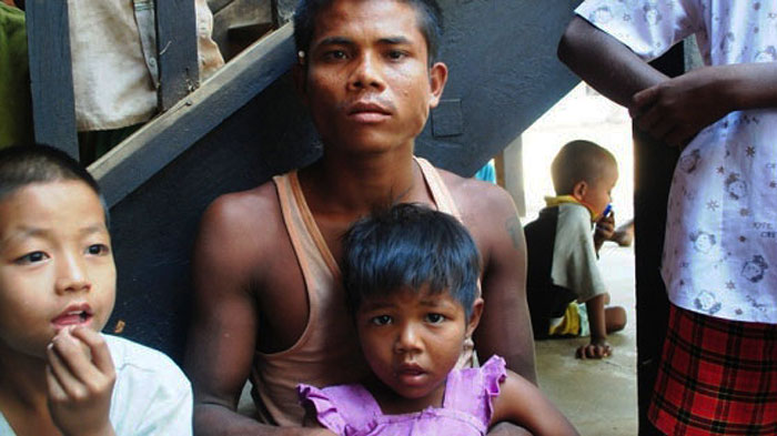 A displaced father and his daughter at a school in Meikhtila, central Myanmar. More than 12,000 people have been displaced following sectarian violence on 20 March 2013