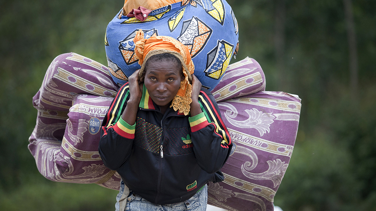A woman IDP arrives in Munigi as Bosco Ntaganda fighter approach from goma, the 1st of March 2013