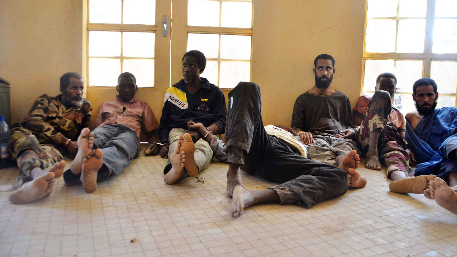 At the gendarme in Gao, detainees captured in Timbuktu region and suspected of assisting the armed groups, wait for further transport to Bamako.The men had to wait at the Gao gendarme for several days before being transferred to the central prison in Bama