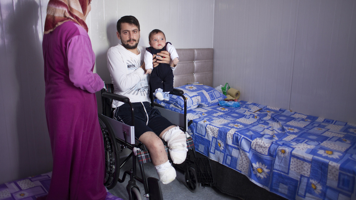 Ahmed Fariz lost both legs fighting for the rebel Free Syrian Army (FSA). He was the sole provider for his parents, wife and two small children. He received free medical treatment in a Turkish hospital and is now living in one of 17 refugee camps in south