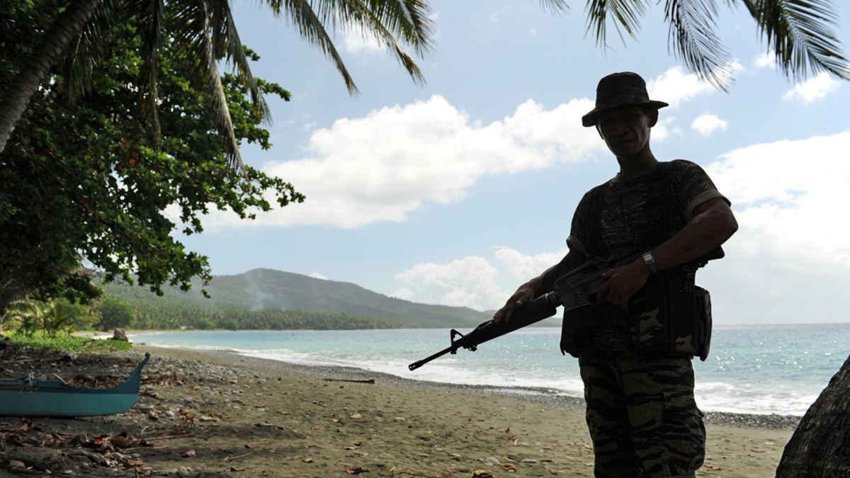A combatant of the Bangsamoro Islamic Armed Forces (BIAF), the armed wing of Moro Islamic Liberation Front (MILF), at Camp Salahuddin in Davao Oriental province, on the Philippines island of Mindanao
