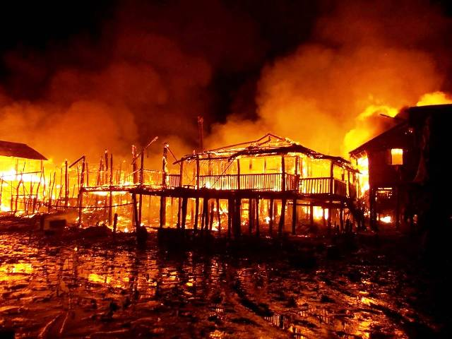 The riverine Rohingya village of Zailya Para in Minbya Township burns after attacks by Buddhist Rakhine mobs in October 2012. More than 100,000 people were displaced in the violence