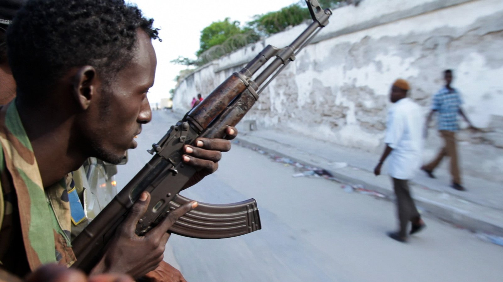 A soldier of the Somali National Army travels through the streets of Mogadishu, Somalia, in the back of a technical. The EU, Britain and other nations pledged significant funds for the reform of the Somali security forces at this year's London Conference