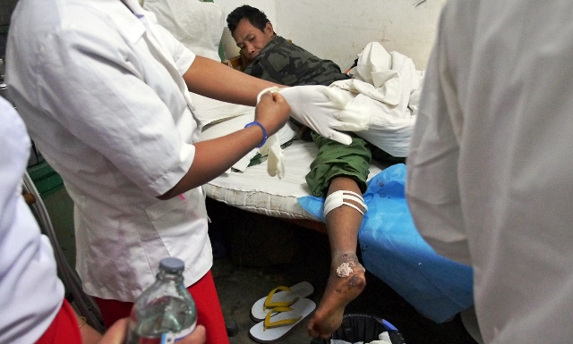 A landmine victim at a hospital in Laiza in Myanmar's northern Kachin State. Health workers say the number of casualties is rising