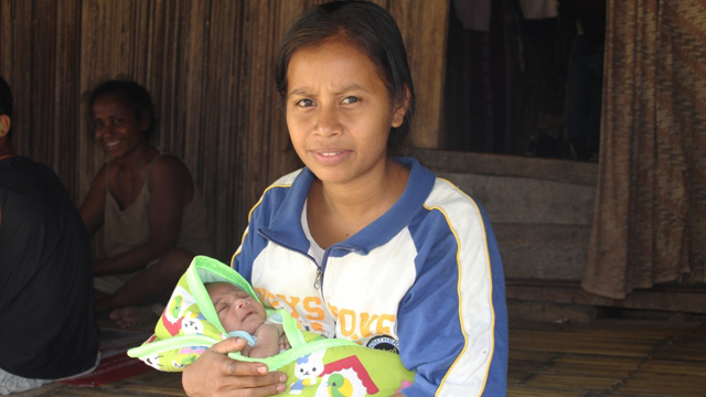 Teregina de Jesus Corterreal and baby son Juzia Mosquita de Jesus in Manufahi District, Timor-Leste