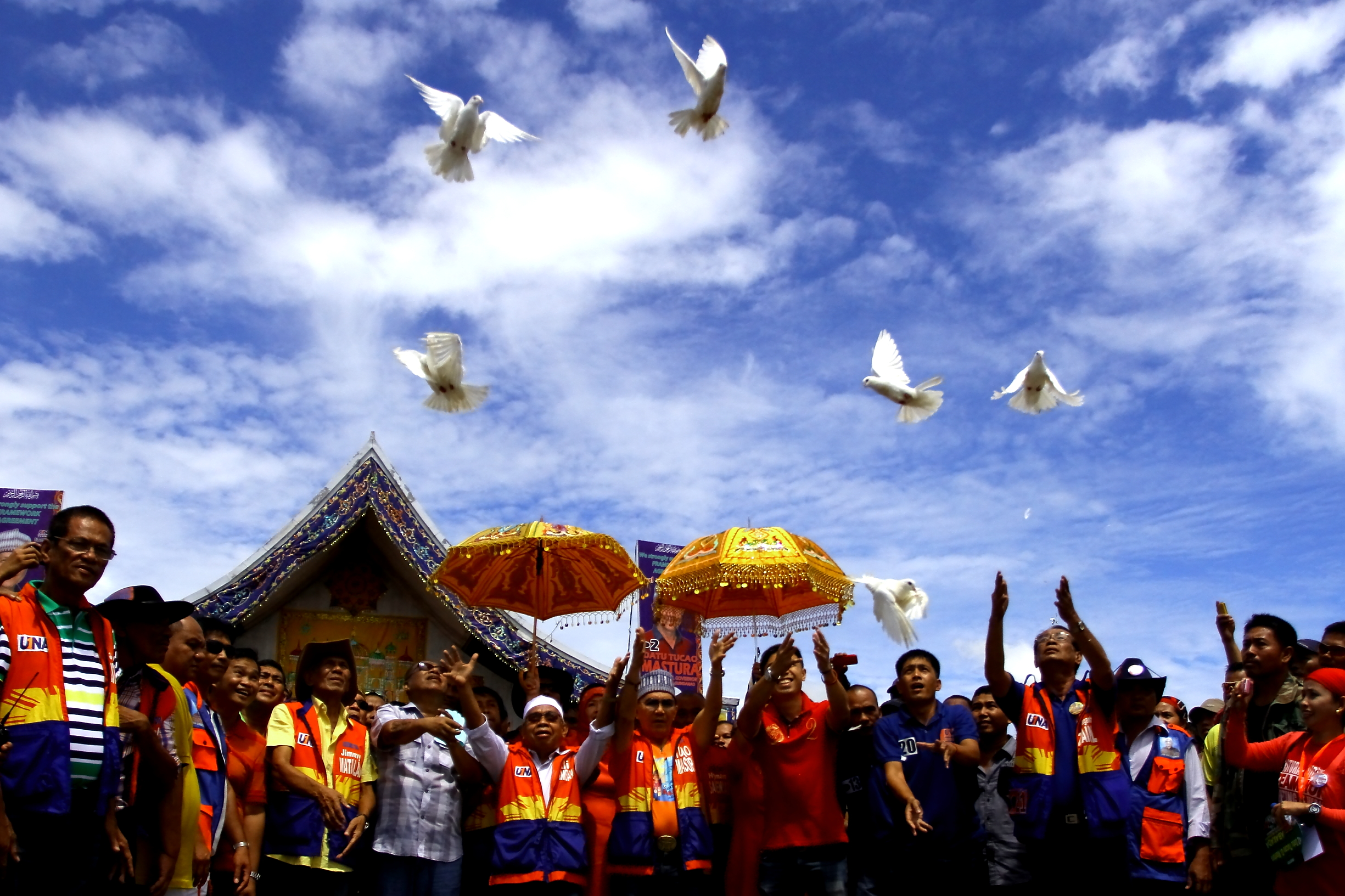 Muslim candidates backed by the Moro Islamic Liberation Front (MILF) release white doves to symbolize peace as the rebels took their first tentative steps to joining a political exercise