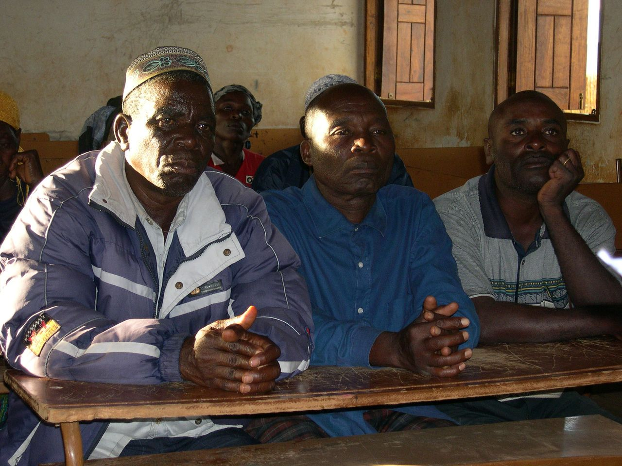 Local leaders at a recent meeting in Bandeze discuss the impact of a plantation project in the area