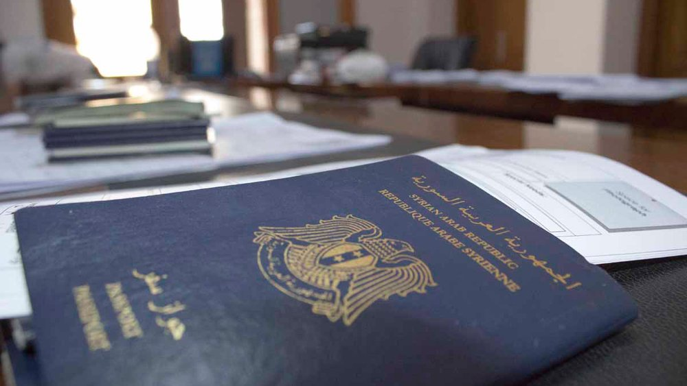 Syrian passport on desk during the UNHCR registration mission in Misrata