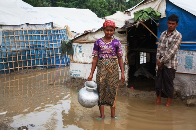 A Rohingya woman outside her makeshift shelter at an IDP camp outside Sittwe following heavy monsoon rains. An estimated 140,000 people, the vast majority Muslim Rohingyas, were displaced by sectarian violence in 2012