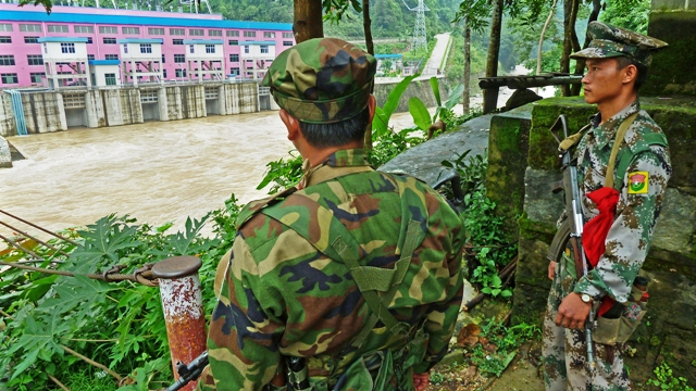 Two Kachin soldiers stand guard opposite a Chinese dam in northern Kachin State. More than 85,000 people have been displaced by the conflict following the collapse of a 17-year-old ceasefire in June 2011