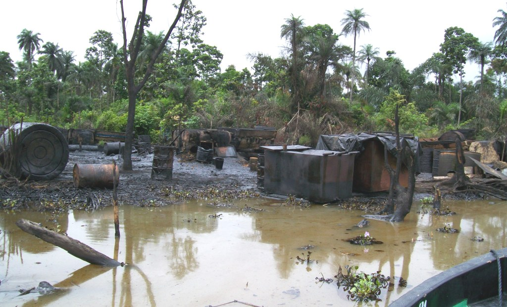 Burnt illegal oil refineries in Warri creek in the Niger Delta
