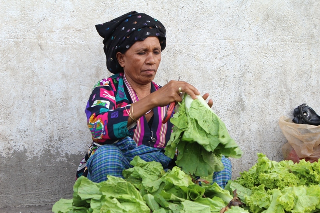 A woman sells lettuce on the streets of Dili. 80 percent of the country's 1.1 million people - and 90 percent of the rural poor - depend on subsistence agriculture for their livelihood, according to the World Food Programme