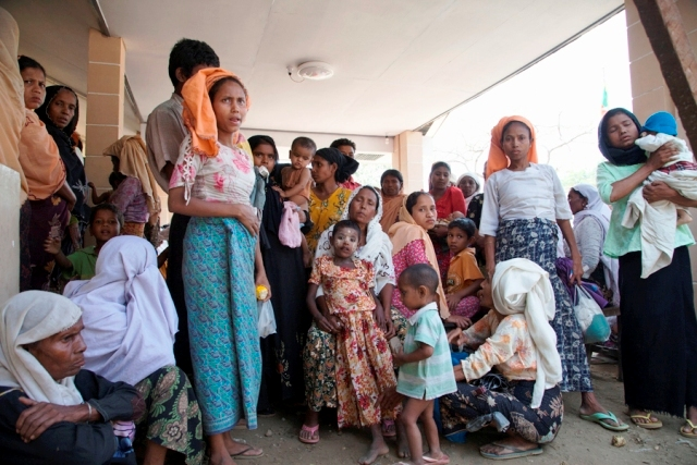 Hundreds of Rohingya IDPs in Rakhine State wait outside this makeshift clinic outside Sittwe, which has only a dozen cots and limited stores of medicines. Health workers predict rising cases of sickness and disease with the onset of the monsoon season.