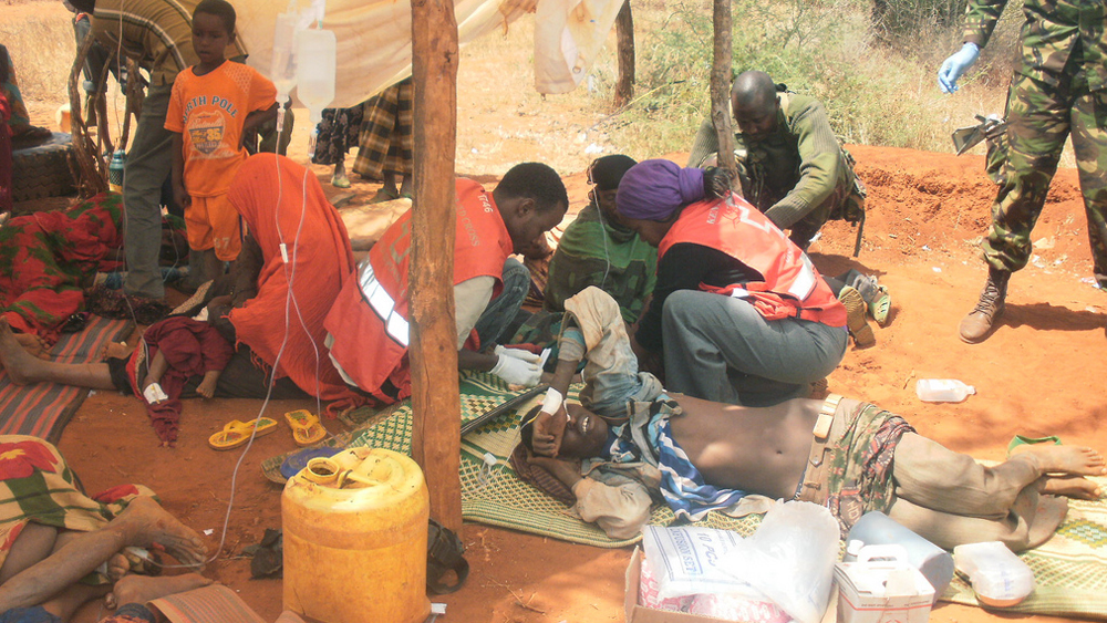 Kenya Red Cross Society personnel assist people injured in retaliatory attacks in Chorogo village in Malkamari division of Banisa District in Mandera