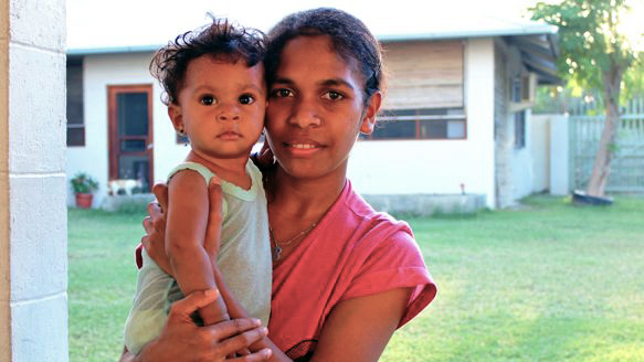 A mother and child look to the camera outside the Dili National Hospital. 58 percent of children under five are stunted (too short for their age) due to chronic malnourishment, experts say