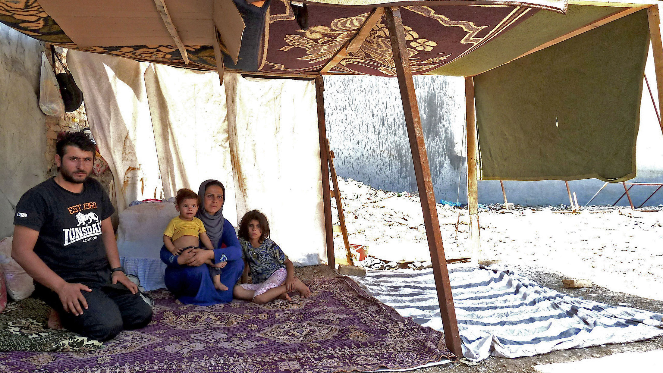 Syrian refugee Mohammed Hassan, 24, with his wife Guzel, 22, and their children in a make-shift tent on Shoresh Road in Erbil, the capital of the semi-autonomous Kurdish region of Iraq. Iraqi Kurdistan is sheltering 95 percent of the 161,000 Syrian refuge