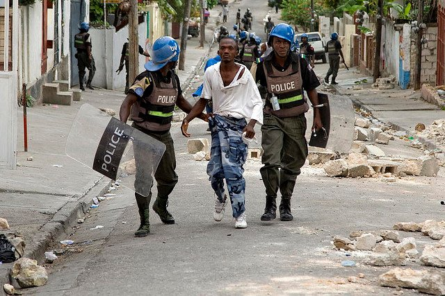 MINUSTAH Police Officers Detain University Student Protesters. 12/Jun/2009. Port au Prince, Haiti