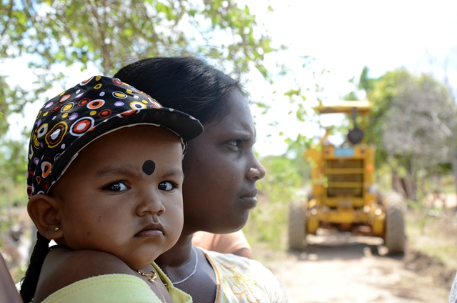 A mother holds her child in northern Sri Lanka. A substantial amount of reconstruction work still remains in the country's former conflict zone