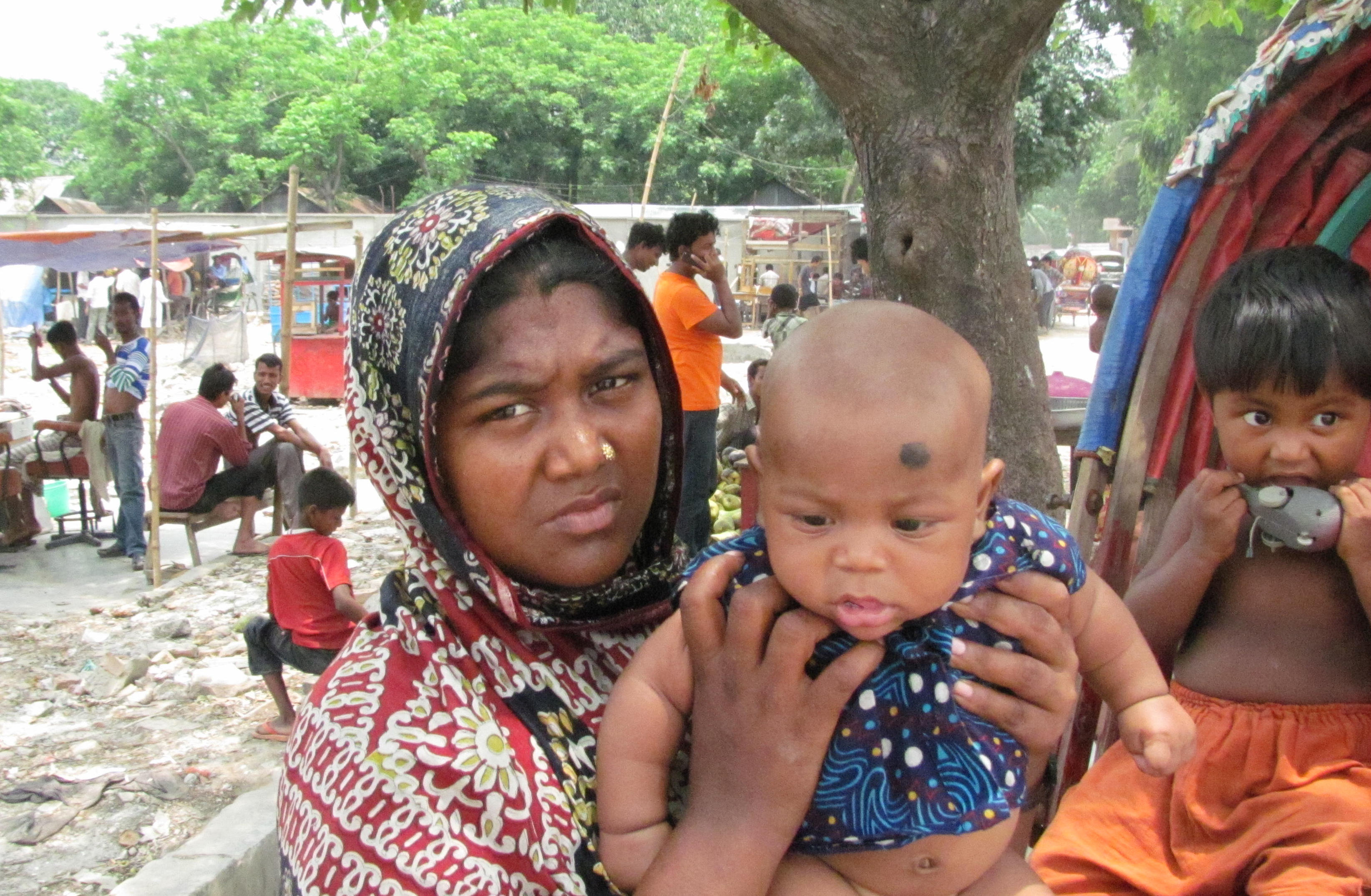 Shopna Begum, 35, in Dhaka's largest slum, Korail