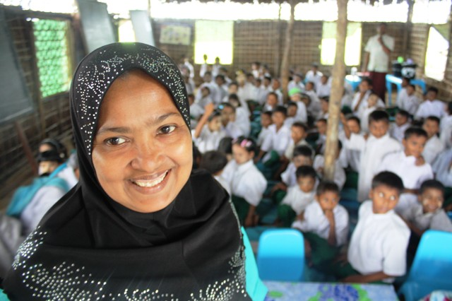 A Rohingya teacher at a UNICEF temporary learning space in Sittwe set up by UNICEF in July 2013 to better address the emergency education needs of more than 23,000 primary school age children (6 to 10)
