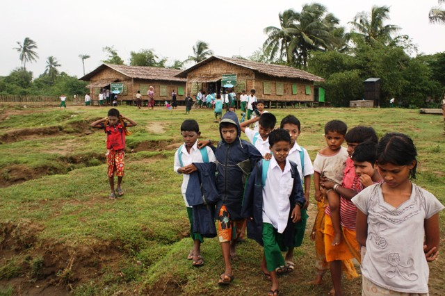 Rohingya children leaving a UNICEF-established temporary learning space outside Sittwe, western Rakhine State. Thousands of children are now receiving emergency education more than one year after two deadly bouts of sectarian violence left more than 140,0