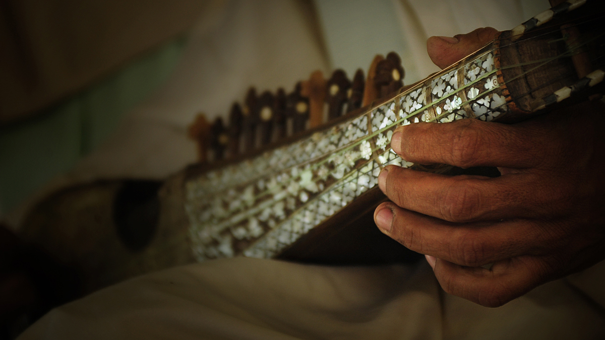 FARAH, Afghanistan – A band member plays the rubab during a musical performance at the Anab Gull Poetry Festival at the Farah Provincial Governors compound in Farah, Afghanistan (May 8, 2010)
