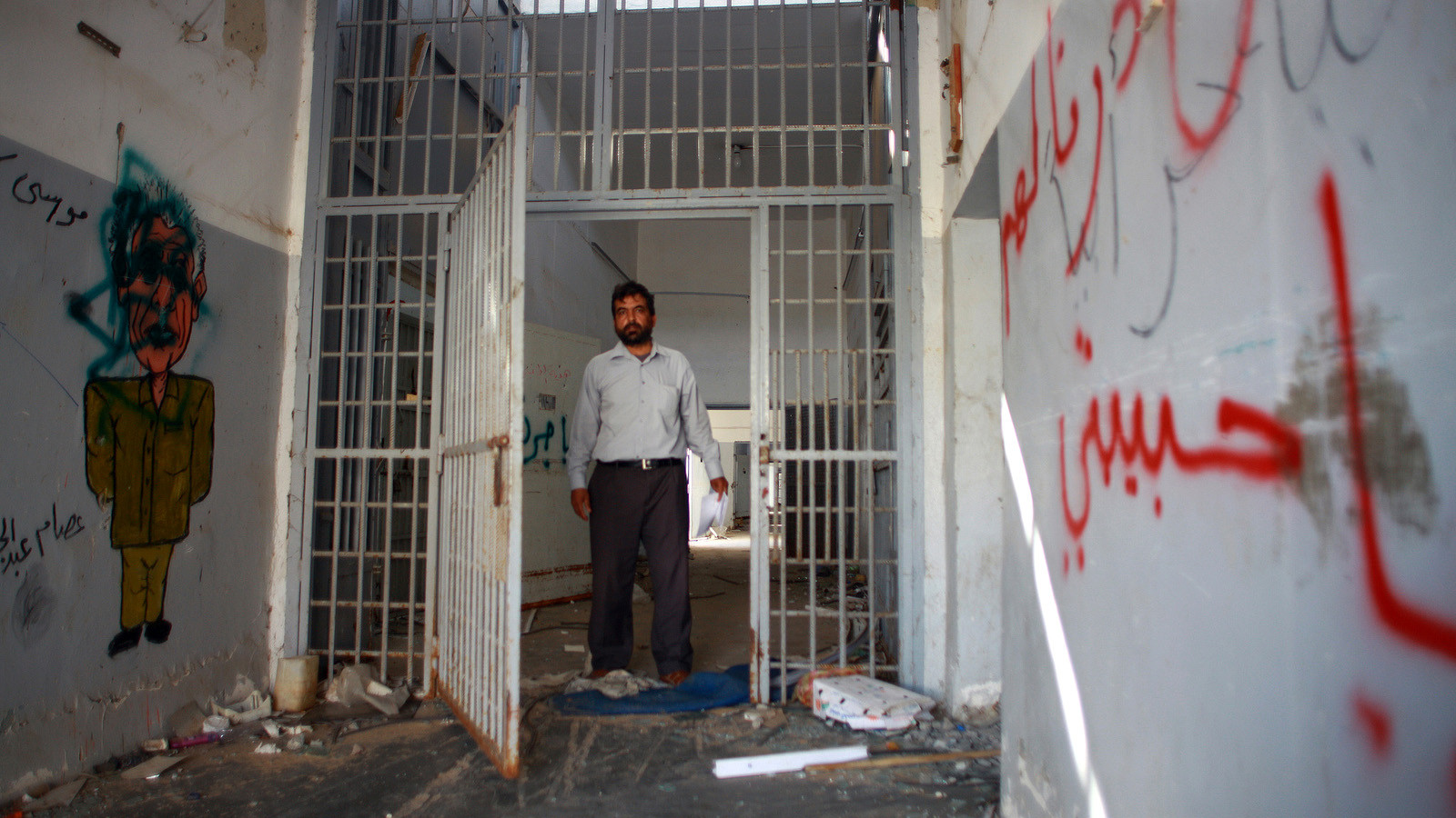 Former inmate on a return visit to his cell at Tripoli's Abu Salim prison where he was held for several years. October 2011
